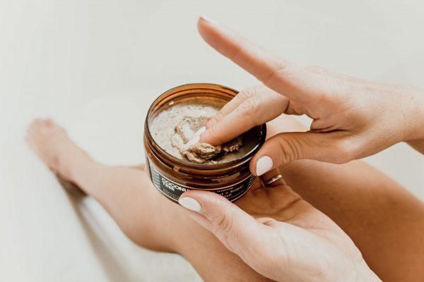 fingers in jar of body polish