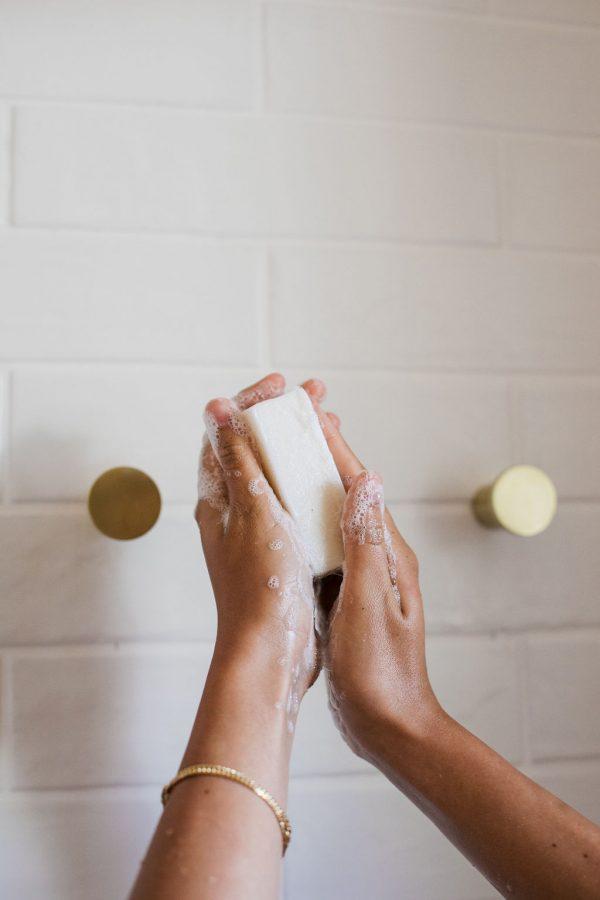 girl holding soap in shower